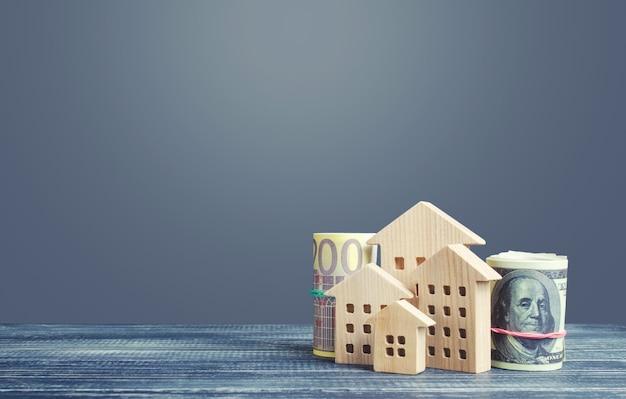 Edifícios residenciais e dinheiro em dólar euro