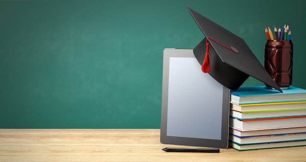 Educação online ensino à distância em casa tablet e pilha de livros com chapéu de pós-graduação copiar espaço