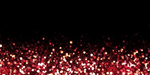 Efeito bokeh vermelho reflete partículas leves e brilhantes de poeira.