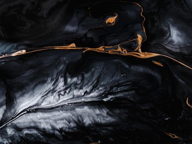 Efeito marmorizado preto e dourado
