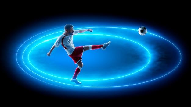 Efeito neon de futebol. jogador de futebol profissional em ação. luz de neon azul