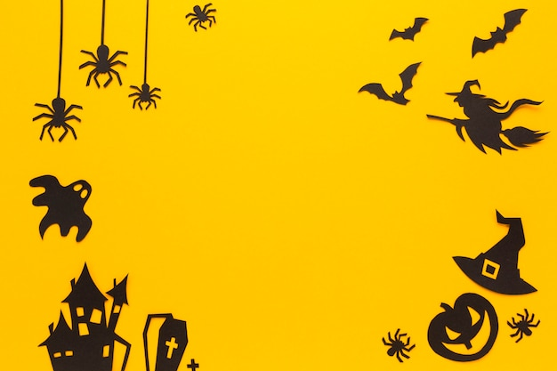 Elementos de festa de halloween com fundo laranja