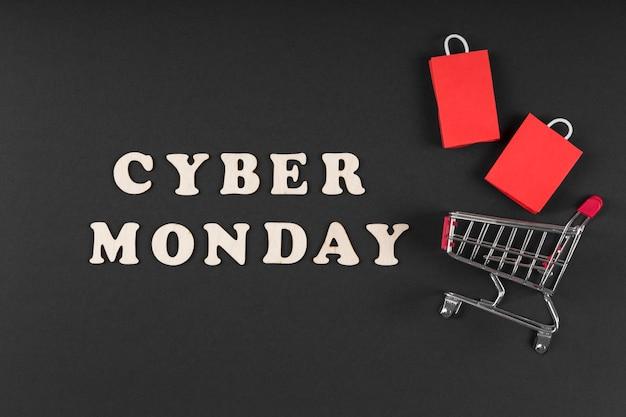 Elementos de venda de evento de cyber segunda-feira em fundo escuro