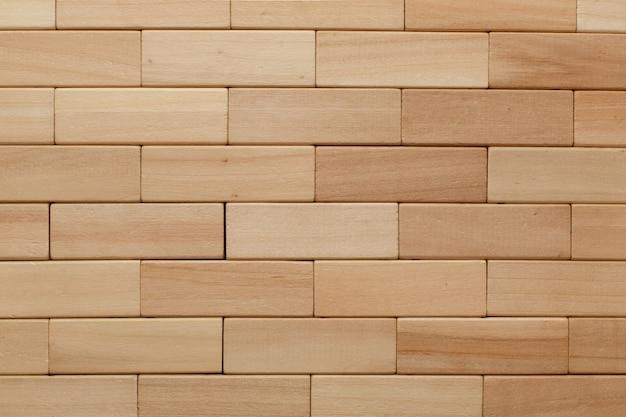 Elementos e componentes de madeira projetam blocos. jogo de madeira perto com espaço para texto. entretenimento familiar interessante e jogo de tabuleiro