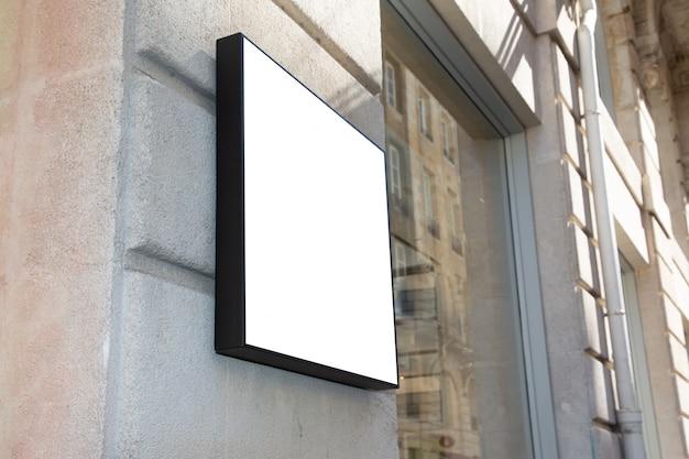 Em branco branco empresa loja sinal mock-se loja na parede
