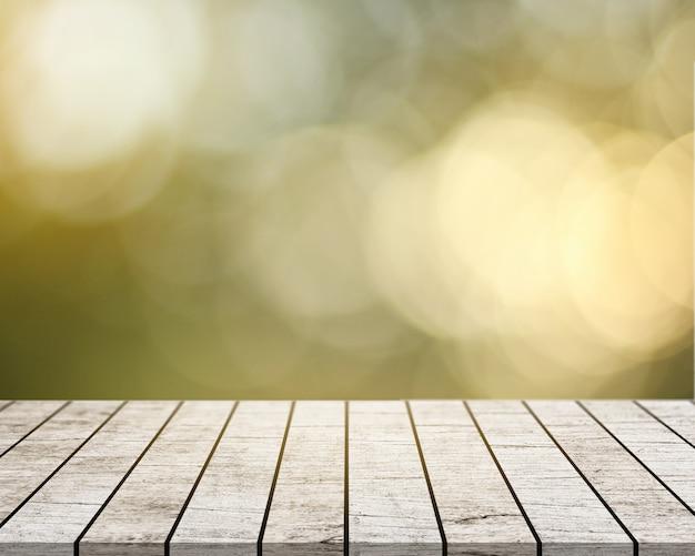 Em uma mesa de madeira branca com um fundo de bokeh