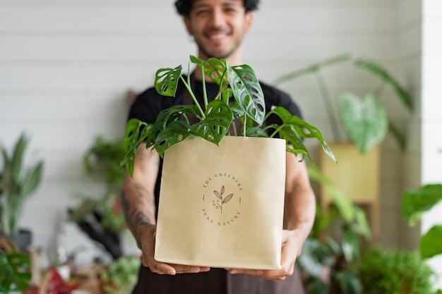 Embalagem de entrega do proprietário da loja da planta