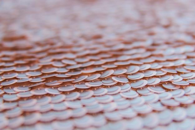 Empalideça - a tela brilhante cor-de-rosa com lantejoulas, fundo abstrato.