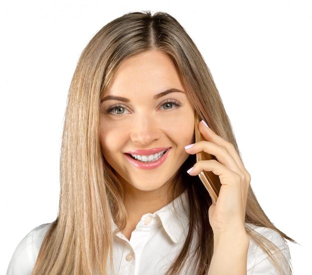 Empresária bem sucedida com telefone celular, isolado no branco