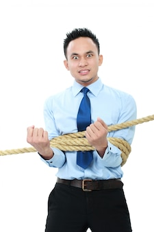 Empresário amarrado com cordas