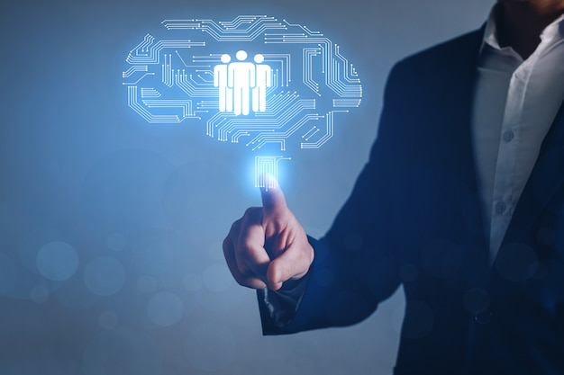 Empresário, apontando o ícone de recursos humanos. recrutamento emprego headhunting conceito