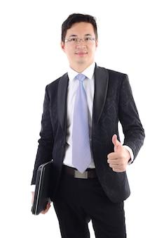 Empresário bem sucedido com laptop e mostrando o polegar para cima