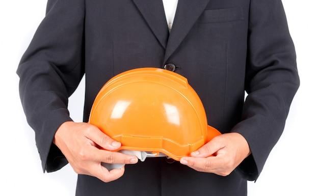 Empresário com capacete de construção. isolado no fundo branco