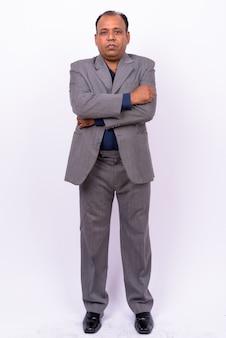 Empresário indiano maduro com excesso de peso em terno com linha do cabelo recuando