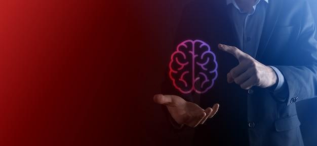 Empresário segurando cérebro abstrato e ferramentas de ícone, dispositivo, comunicação de conexão de rede do cliente no conceito de tecnologia, ciência, inovação e negócios futuros de desenvolvimento inovador virtual.