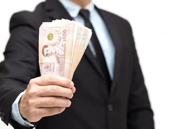 Empresário, segurando o dinheiro baht tailandês