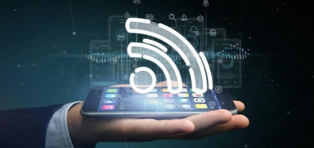 Empresário, segurando um ícone de wifi com dados ao redor