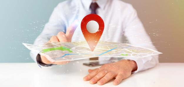 Empresário segurando um porta-pino de renderização 3d em um mapa