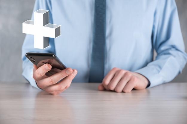 Empresário segurar 3d ícone de adição, homem segurar na mão oferece coisas positivas, como lucro, benefícios, desenvolvimento, rsc representado pelo sinal de adição. a mão mostra o sinal de adição.