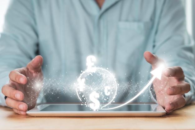 Empresário usando tablet com troca de moeda
