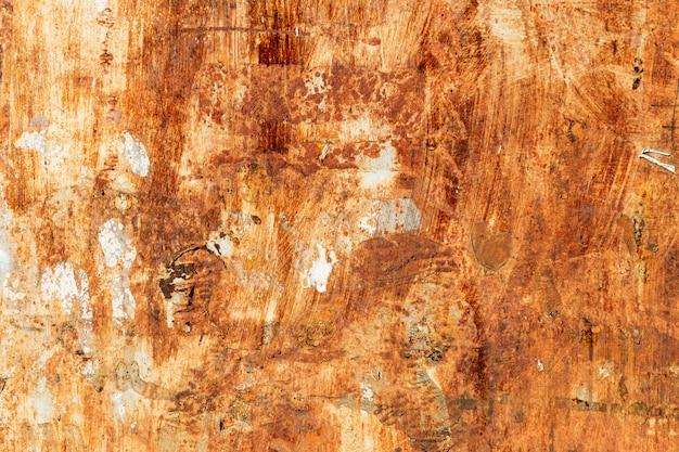 Enferrujado na superfície do ferro velho, textura de fundo