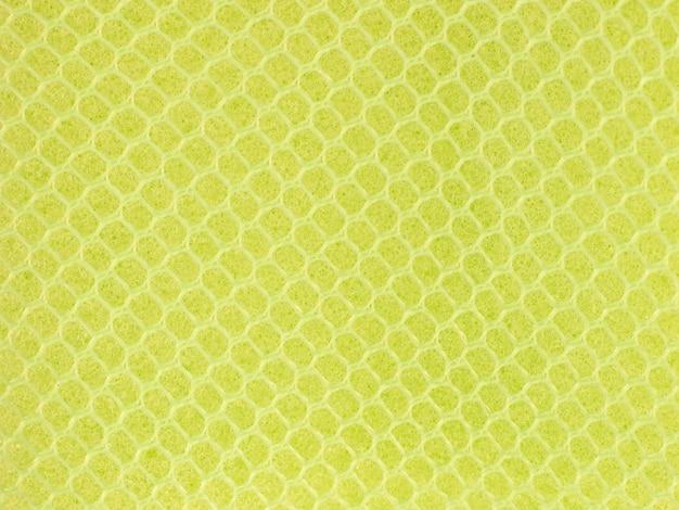 Engranzamento de fio amarelo no fundo da superfície da esponja.