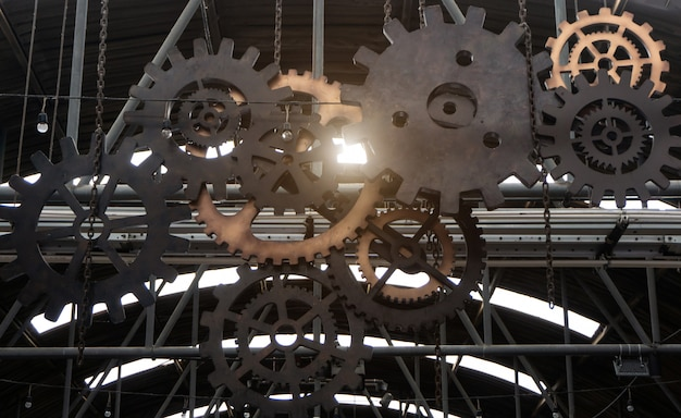 Engrenagens do motor rodas de peças da máquina e efeito da luz do sol