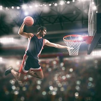 Enterramento acrobático de um jogador de basquete na cesta no estádio