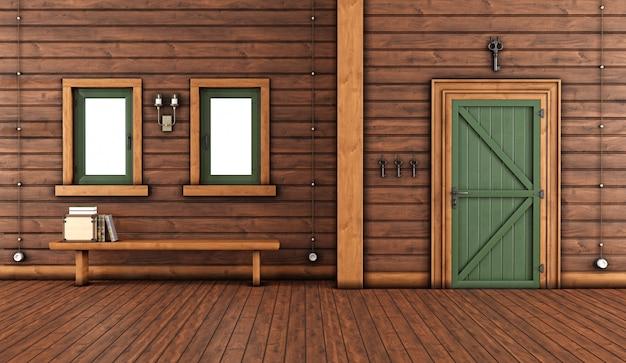 Entrada de casa de madeira com porta da frente fechada e banco