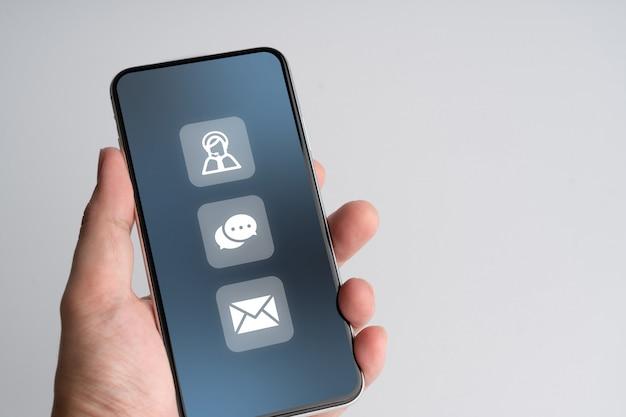 Entre em contato conosco ícone de negócios no telefone inteligente