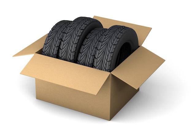 Entrega de pneus conjunto de quatro pneus em caixa de papelão para entrega de pedido isolado no branco