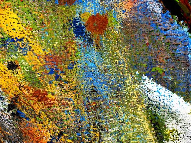 Entregue a tração o fundo colorido do sumário da pintura a óleo da textura em de madeira.