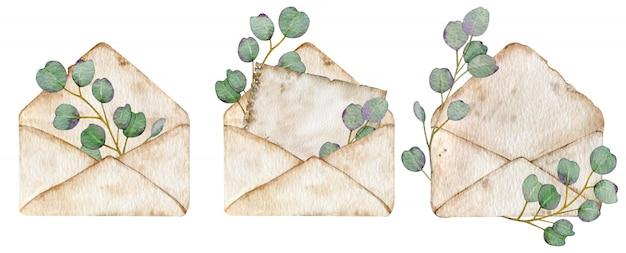 Envelopes vintage com folhas de eucalipto. ilustração em aquarela de três envelopes abertos marrons.