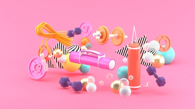 Equipamento de fitness no meio de bolas coloridas em um espaço rosa