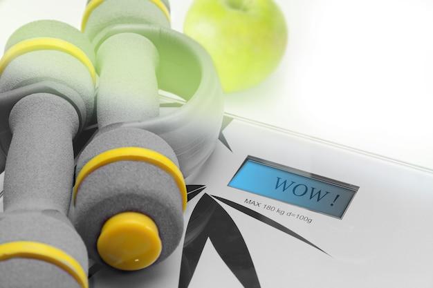 Equipamentos de ginástica, halteres e balanças de maçã para fitness