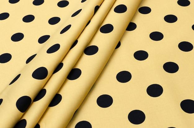 Ervilhas pretas de tecido de algodão em bege
