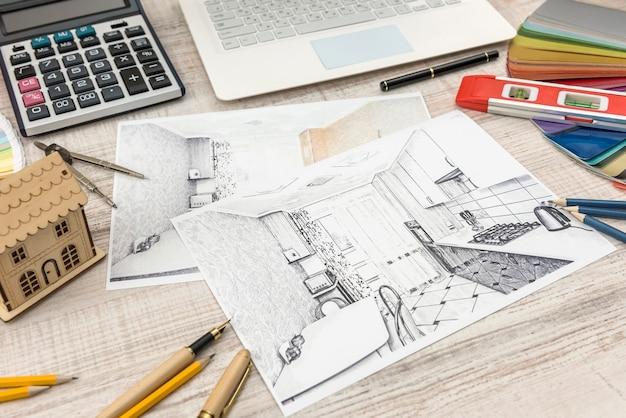 Esboço do projeto arquitetônico com ferramentas de engenharia e amostrador de cores