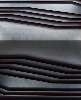 Escadas abstratas em escadas mínimas do estilo das etapas preto e branco, abstratas na cidade.