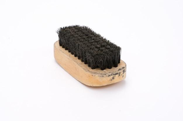 Escova de sapato velha com alça de madeira