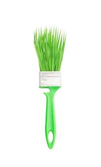 Escova verde com grama de primavera, isolada no fundo branco