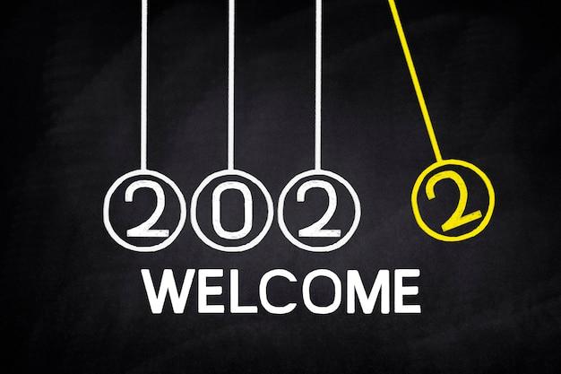 Escreva saudações para 2022 no quadro negro
