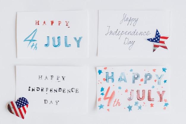 Escrevendo feliz 4 de julho em cartões