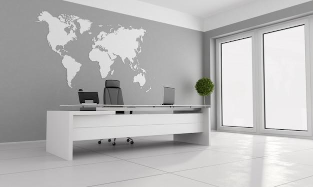 Escritório minimalista com mesa branca e mapa-múndi na parede