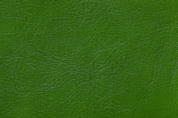 Escuro - fundo de couro verde da textura, close up.