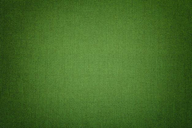 Escuro - fundo verde de um material de matéria têxtil com teste padrão de vime, close up.