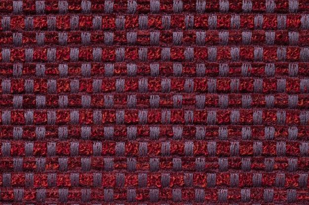 Escuro - vermelho da matéria têxtil quadriculado do teste padrão, close up. estrutura da macro de tecido de vime.