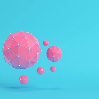 Esferas abstratas rosa poli baixa em fundo azul brilhante