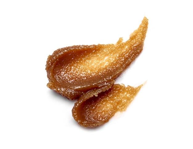 Esfoliante de açúcar isolada no branco