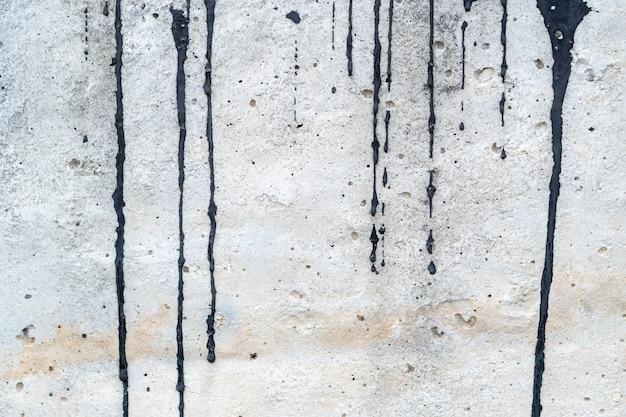 Esfregaço de cor preta no cimento