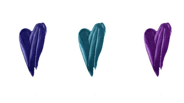 Esfregaço de coração azul, verde e roxo de gloss. textura cintilante bonita.